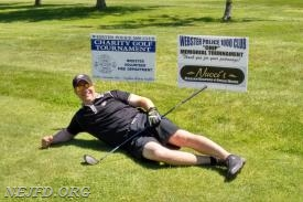 Webster Police Officer and Webster Volunteer Firefighter Dave Herrle takes a quick break at the hole cosponsored by the Webster Volunteer Fire Department.    Photo provided by Chief Smith.